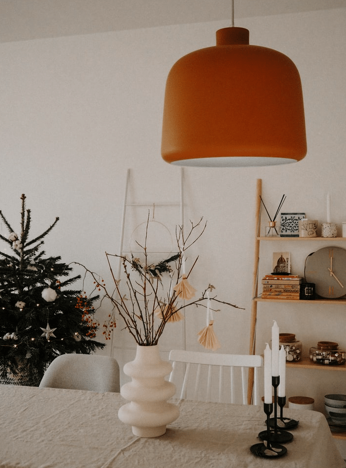 bohemian home decor with an orange lap and a Christmas tree