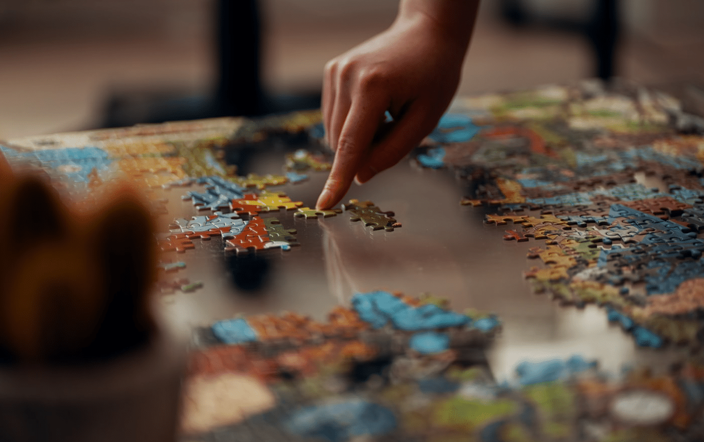 putting together a jigsaw puzzle